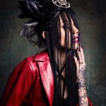 Tattooed Queen of Blood Shonda Mackey models leather and headpiece
