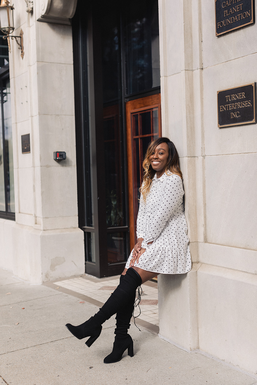 Jordan Taylor C - 6 Free Apps that EVERY Blogger Needs, black woman in white polka dot dress and stuart weitzman over the knee leaning against a wall, apps every blogger, apps every blogger needs, apps every blogger