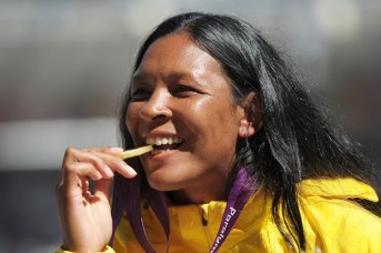 LONDON, ENGLAND - SEPTEMBER 08:  Gold medallist Shirlene Coelho of Brazil poses on the podium during the medal ceremony for the Women's Javelin Throw — F37/38 final on day 10 of the London 2012 Paralympic Games at Olympic Stadium on September 8, 2012 in London, England.  (Photo by Dennis Grombkowski/Getty Images)