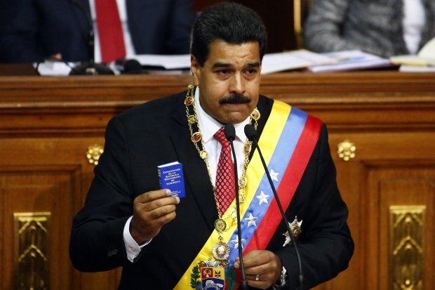 REFILE - CORRECTING HEADLINE Venezuelan President Nicolas Maduro speaks at the National Assembly in Caracas October 8, 2013. Maduro was going to parliament on Tuesday to seek decree powers he says are needed to tackle corruption and fix the economy but opponents view as proof he wants to rule as an autocrat. The National Assembly, where Maduro's socialist government has a nearly two-thirds majority, is widely expected to grant him the fast-track legislative powers in a revival of a measure used several times by his predecessor, Hugo Chavez. REUTERS/Jorge Silva (VENEZUELA - Tags: POLITICS)