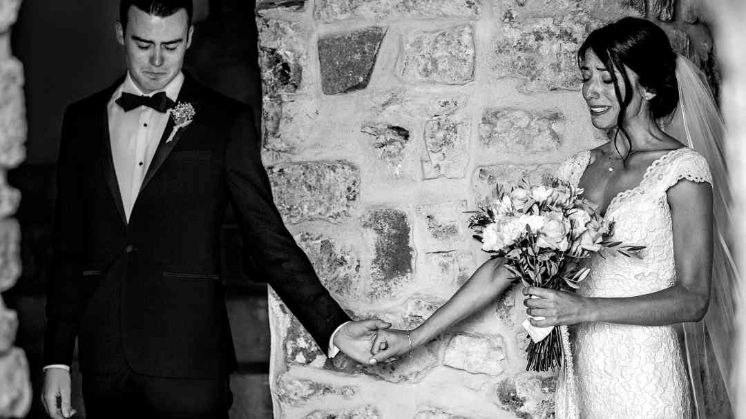 Emotional Bride and Groom touching hands