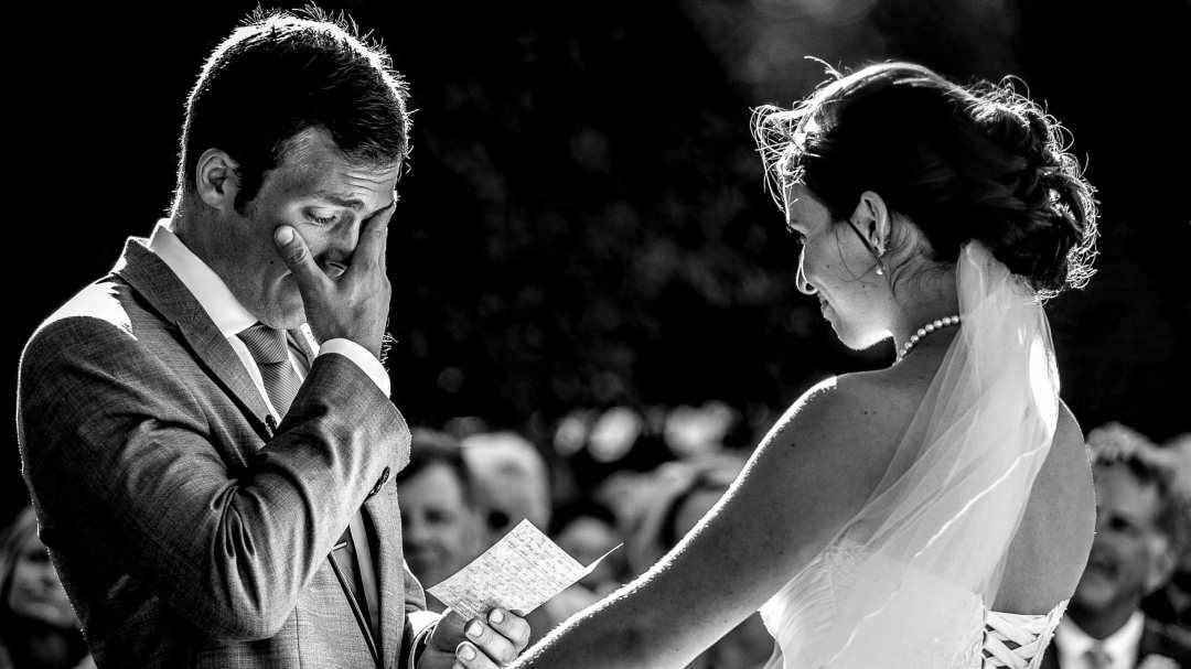 Emotional Groom saying vows to Bride