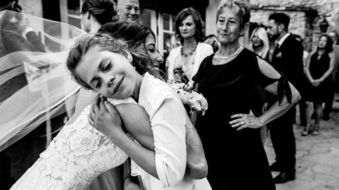 Bride hugging small girl