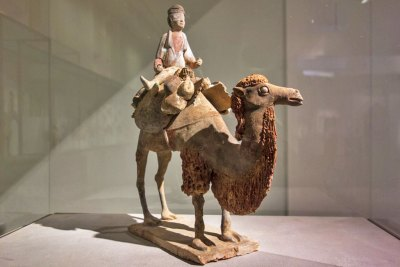 Polychrome terra cotta mingqi statuette of a camel driver - Tang  Dynasty (seventh century A.D.).