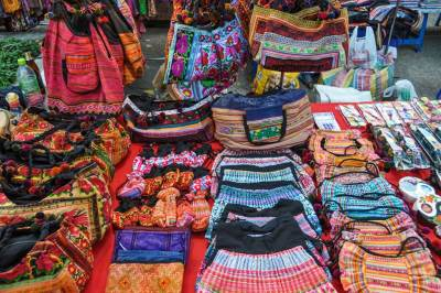 The Hmong people are famous for their vibrant clothing and textiles.