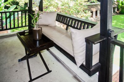 My balcony with its built-in loveseat overlooks a serene courtyard.
