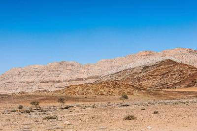 West of the Kuiseb Pass, the desert is framed by  mountains worn smooth  by time and wind.