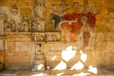 Remains of original polychrome frescoes at the Abbey of Cadouin.