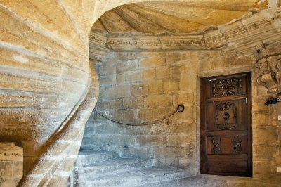 The staircase connecting  the Gothic and Renaissance wings is  made of 93 stone slabs winding around a central spiral column.