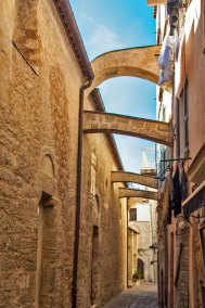In earlier times, the flying arches over these narrow alleyways were used to bring water into the homes.