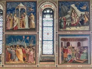 The Passion of Christ occupies the lower tier of the frescoes cycle.  Note Juda's kiss in the lower left quadrant.