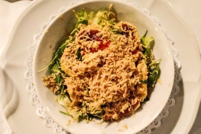 Cafe de l'Academia mixed green salad topped with duck liver paté.