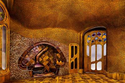 Casa Batllò - This whimsical mushoom-shaped fireplace is a courting corner. One side is wider than the other, so a couple can sit on tone bench while their chaperone sits on the narrower one.