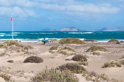 On the northwestern side of the island, Playa de Famara is a favorite with surfers.