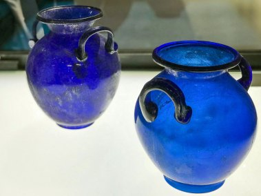 The collection of Gallo-Roman glassware features remarkable royal blue amphorae.