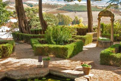 Elaborately landscaped gardens make the most of the spectacular views.