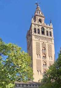 The bell tower of the Seville Cathedral (a.k.a. La Giralda) was originally of minaret of the12th century Aljiama mosque.