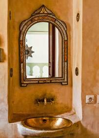 Ancient copper fixtures had a traditional touch to the bathroom.