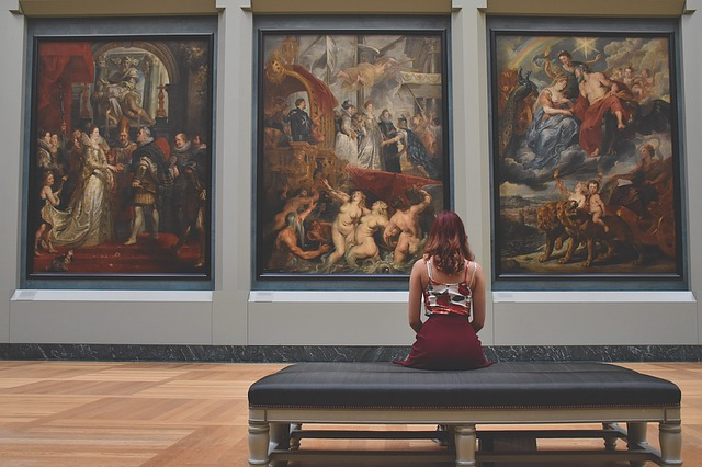 A girl looking at paintings