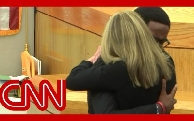 See victim's brother hug convicted ex-cop Amber Guyger