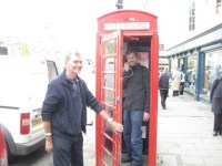 """Uncle Raymond holds the door while I pretend to call someone from a """"red telephone box"""""""