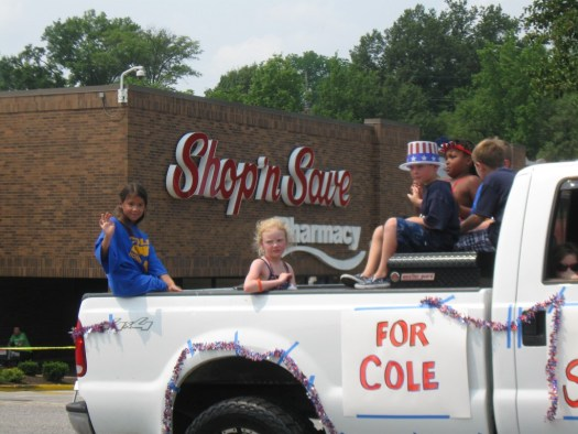 Ludi got to ride in a truck near the end of the Fourth of July parade with the rest of the Ferguson Swim Team.