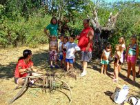 Explaining the project to a family of visitors to the island
