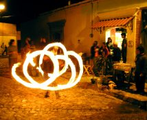 Fire spinner outside the gallery at the opening