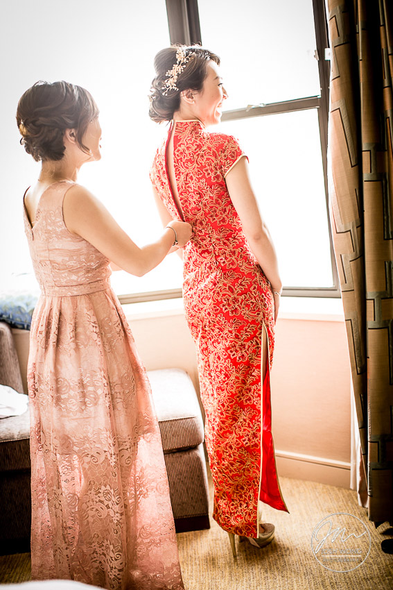 The bride changes into a traditional Chinese long dress ahead of the Tea Ceremony. New York Botanical Garden Wedding Pictures by NYC Wedding Photographer Josh Wong Photography