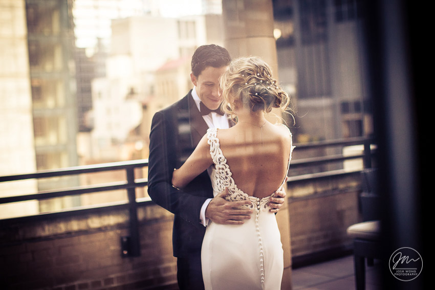 The First Look on the balcony of the bridal suite at Marriott East Side, New York City. Wedding pictures by top NYC wedding photographer Josh Wong.