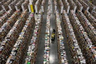 Inside the Amazon warehouse. A worker gathers items for delivery.