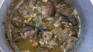 Goat meat pepper soup is simmering on a low heat