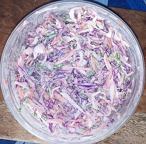 Stirring of salad-cream properly to combine