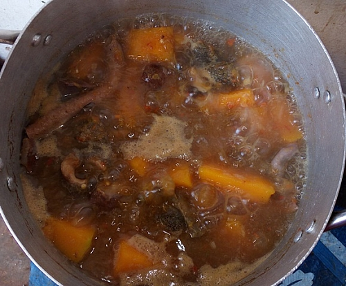 Pumpkin chunks becoming very soft, just about dissolving into the soup