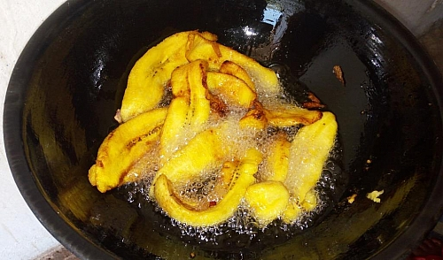 Once the side that is facing the bottom of the pot has turned brown, flip over to the other side, until the chips are evely fried.