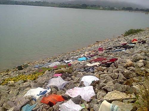 Human activity going on at the bank of pankshin water dam