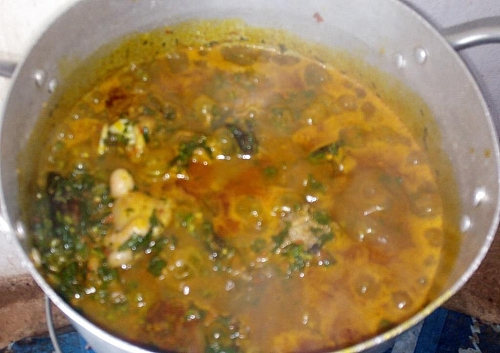 Edikaikong soup simmering on a low heat