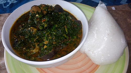 Edikaikong soup is served with eba. Enjoy your meal!