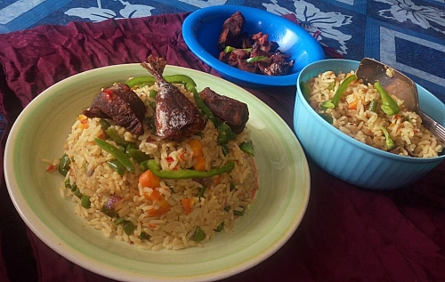 Serving of coconut rice with beef and fish