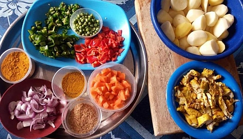 Ingredients for cooking chicken and curried potato porridge