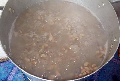 After 30 minutes,the beans will turn soft or almost cooked, you can then add the sweet potatoes into the content to cook
