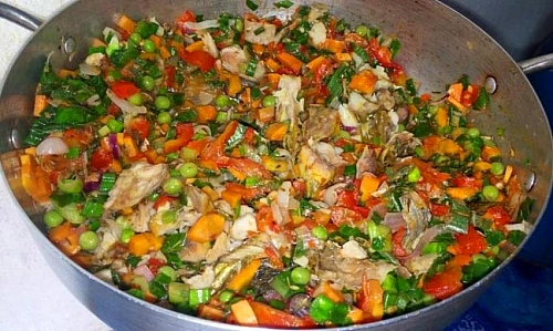 Cooking of vegetables in vegetable oil for Sweet potato and White kidney beans porridge. You can add all the vegetables to the porridge directly without having to fry it first, it