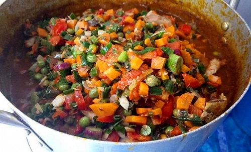 Vegetables are being added to the sweet potato and White kidney beans porridge, they add more beautiful colour to the porridge