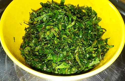 Shredded Basil leaves: As the rice is bubbling, start dressing the basil (scent leaves)