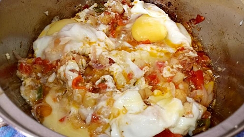 You can add some chopped green chilies or green peppers to your egg and potato recipe while waiting for the egg to set