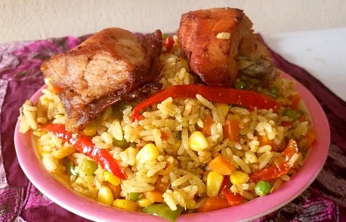 Coconut fried rice served with fried chicken