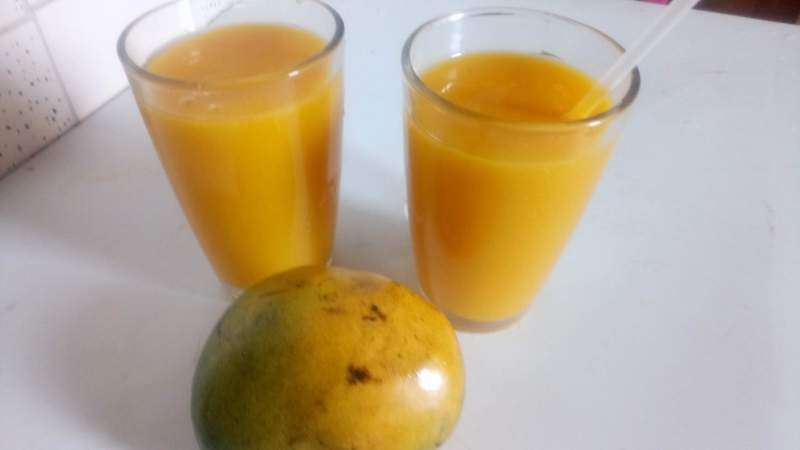 A glass cup of Mango Juice