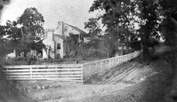 Photograph of home with fence