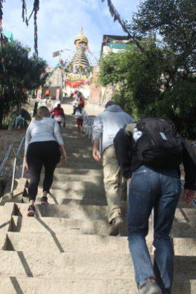Climbing the stairs to Swayambhunath Temple