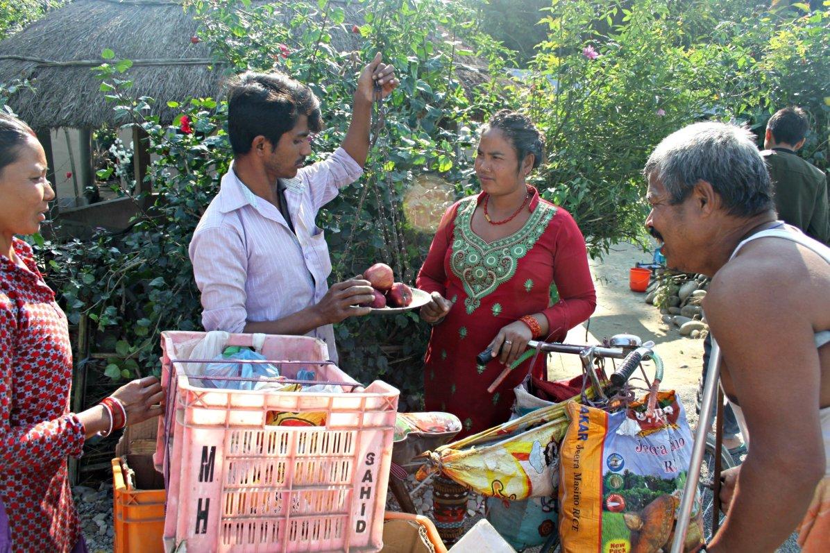 Woman buying fruit in Nepal